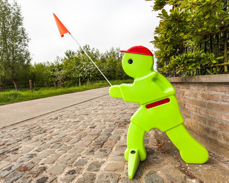 slow down: sign doll for driving slow on the street