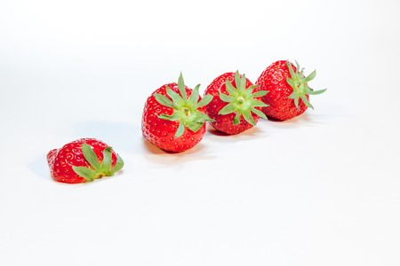 slightly: this strawberries lightly shelf on the table