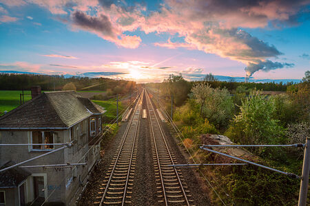 vanishing: a railway whit an Vanishing point in the distance and sunrise Stock Photo