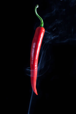 peper: red chilli peper whit background black isolate