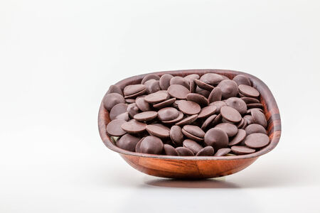 on white background, there is a bowl with brown chocolate photo