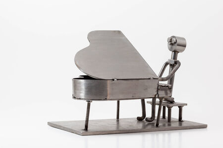 percussionist: on white you have and stainless steel Jazz Piano Stock Photo
