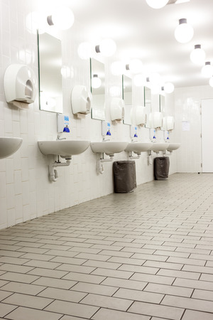 Mens restroom in an public building in white and black doors photo