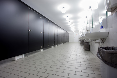 public toilet: Mens restroom in an public building in white and black doors Stock Photo