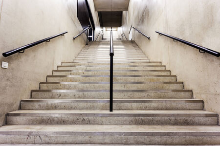 concrete stairs: in an big building is there an long staircase