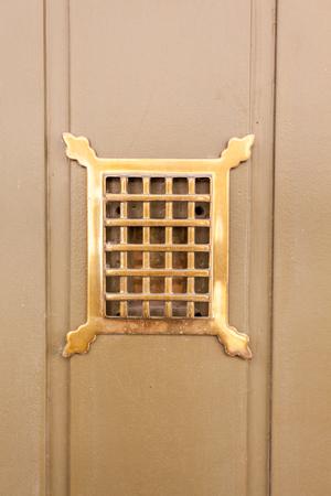 peephole: wooden door whit an Peephole in copper frame