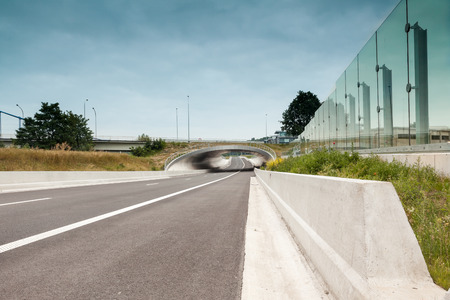 disappears: motorway in the morning whit bridge that disappears into the distance Stock Photo