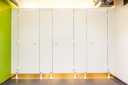 public house: Mens restroom in an public building whit white doors