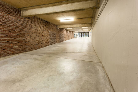 entranceway: an long corridor in large building with cascading passeth Stock Photo