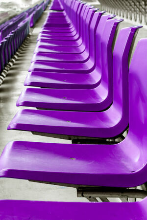 row of purple plastic chairs that disappear into the distance Reklamní fotografie