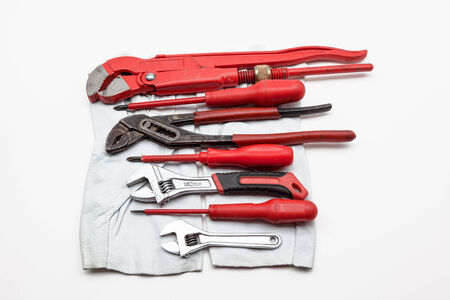 red wrench Isolated on white background whit work gloves photo