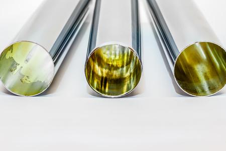three chrome tube or siphon tube on a white background photo