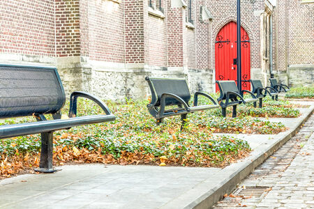 on an platform there is an iron street bench where you can rest cozy photo