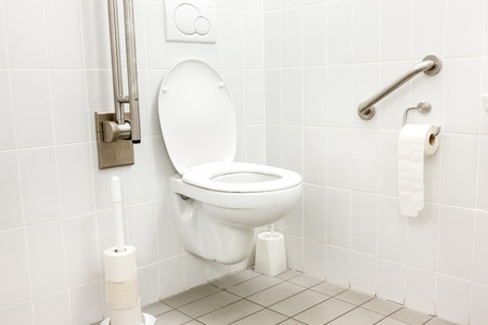 public disabled toilet in a large building of the University Imagens