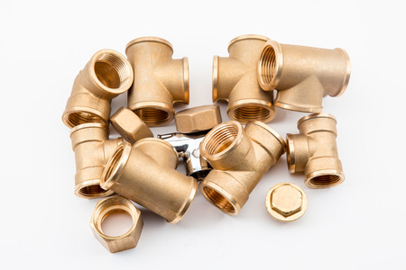 on a white background there are several copper fittings with a stop Stock fotó