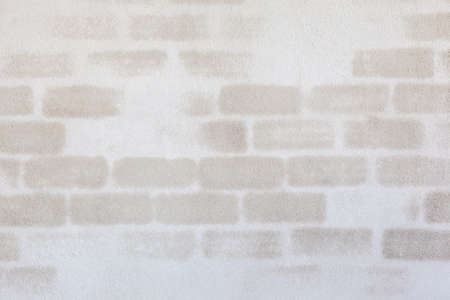 exposed concrete: an concrete wall with exposed stone by the rising damp