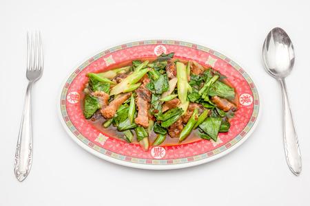 kana: kana moo krob is an Thai food on an plate