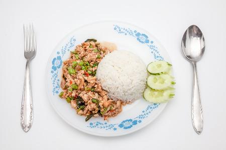 kapow: pat kapow with rice on a plate, a thai dish Stock Photo