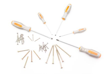 slotted: several screwdrivers and screws, such as cross slotted screwdriver Stock Photo