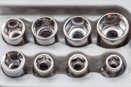 sockets: metal sockets is in a plastic socket wrench holder