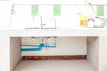 in the kitchen there is a sink built into stone 스톡 콘텐츠