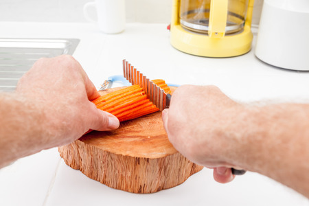 serrated: in the kitchen, I peel a carrot into pieces to be cut with a serrated knife