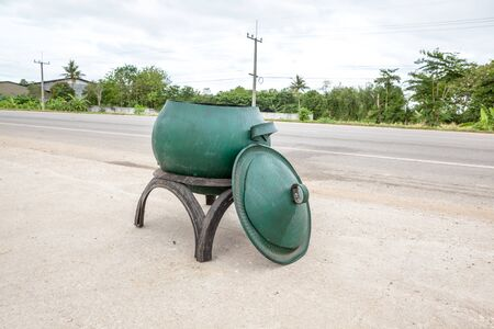 garbage bin: garbage bin made from old rubber tires on public roads