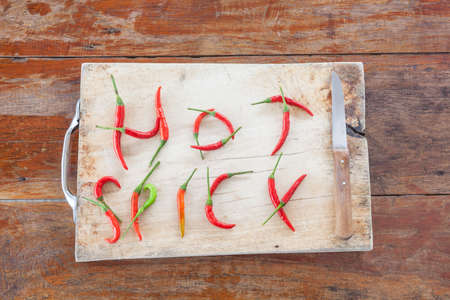 spicy plant: red and green pepper are hot and spicy vegetables on a cutting plant located with a knife potatoes Stock Photo