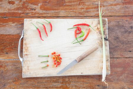 spicy plant: red and green pepper are hot and spicy vegetables on a cutting plant located with a knife potatoes and lemongrass
