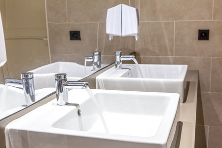 bathroom equipment: in the bathroom there is a water tap that is open