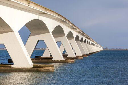 longitudinal: under a long bridge a hole through the pillars with a longitudinal perspective Stock Photo