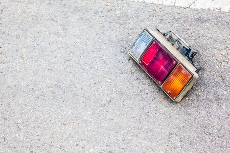 taillight: auto accident on the road, and an taillight on the ground Stock Photo