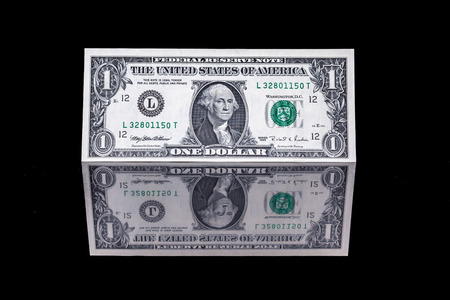 one dollar bill as well as the front and the back with reflection