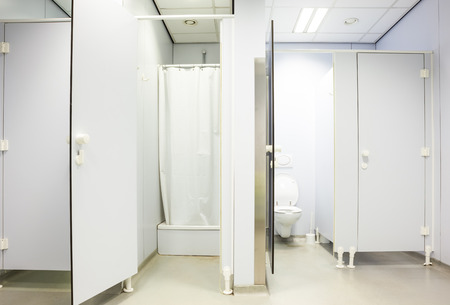 public toilet: an public toilet and an shower in an public building