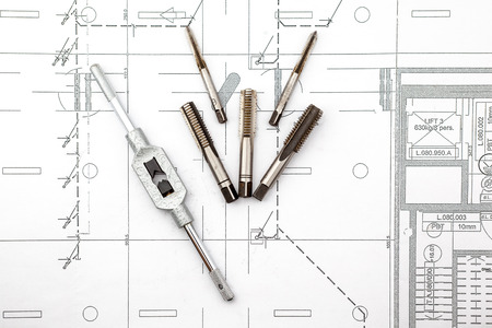 tool and die: tapping operation plus spanner on an house plan