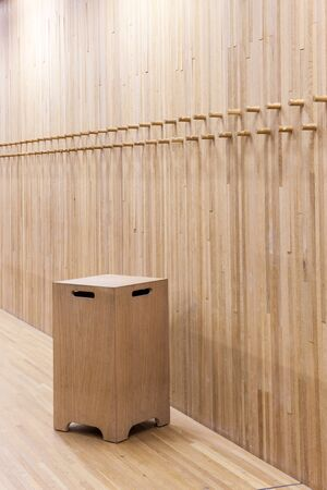 coat rack: an wall from wood whit some coat rack in wood and wooden chair