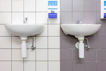 public restroom: in an public restroom hangs on an wall of an white sink