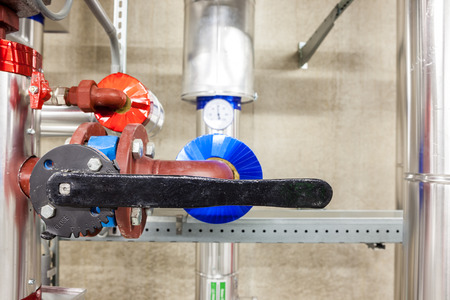 collector: in an large building, there is an collector heating with an butterfly valve Stock Photo