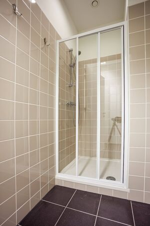 jet stream: an shower with shower door in an public building