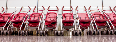 prams: several strollers in the departure hall of the airport Stock Photo