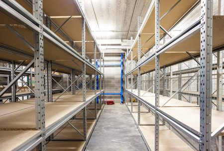 empty storage racks in a building with security