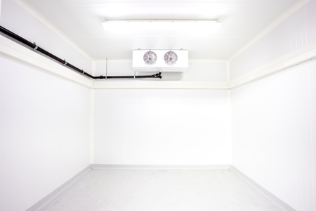 cold: an empty industrial room refrigerator with two fans