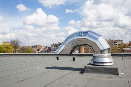 flat roof: inox Chimney on the flat roof in the city