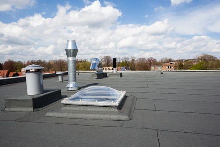 inox Chimney on the flat roof in the city Stok Fotoğraf - 58534474
