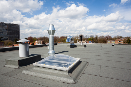 roof top: inox Chimney on the flat roof in the city