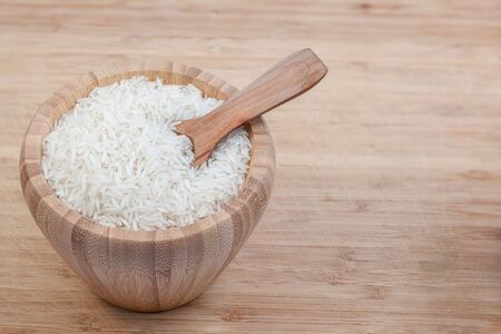 basmati rice: these herbs are basmati rice in an wooden bowl with spoon