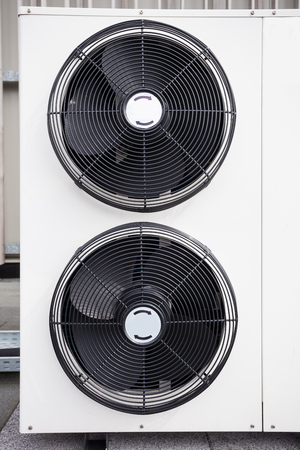 outside machines: different cooling elements of the building on the roof Stock Photo