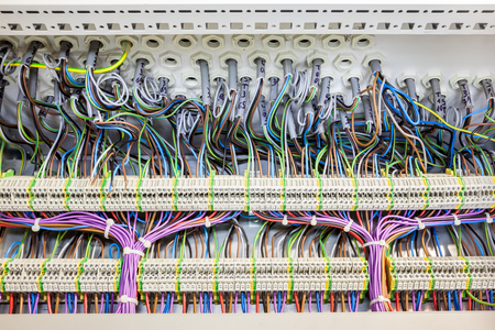 in an fuse box there are an lot of electrical cables tar stock in an fuse box there are an lot of electrical cables tar stock photo