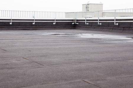 an flat roof with roofing and fencing 스톡 콘텐츠