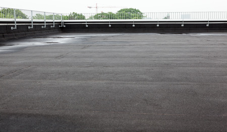 flat roof: an flat roof with roofing and fencing Stock Photo